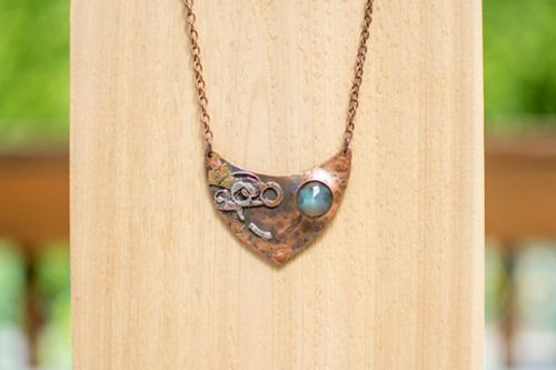 Bi-metal fused copper pendant with faceted labradorite window setting