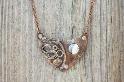 Bi-metal sterling and copper pendant with dendritic agate stone riveted to embossed copper backplate and copper chain
