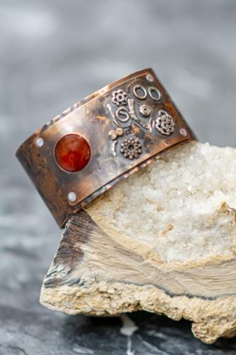 Bi-metal sterling and copper bracelet with carnelian  stone riveted to embossed copper bracelet