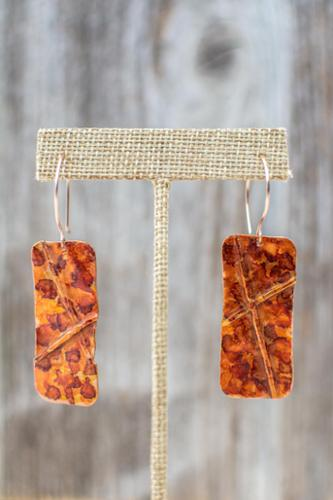 Copper fold formed earrings with alcohol ink patina on niobium earwires